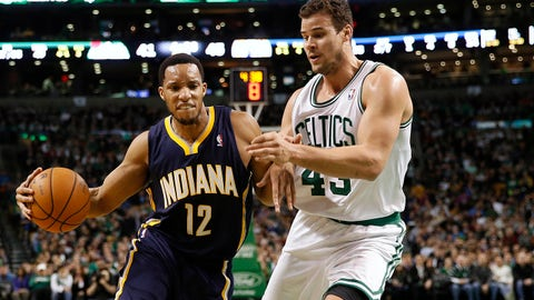 Mar 1, 2014; Boston, MA, USA; Indiana Pacers small forward Evan Turner (12) drives on Boston Celtics center Kris Humphries (43) during the second quarter at TD Garden. Mandatory Credit: Winslow Townson-USA TODAY Sports