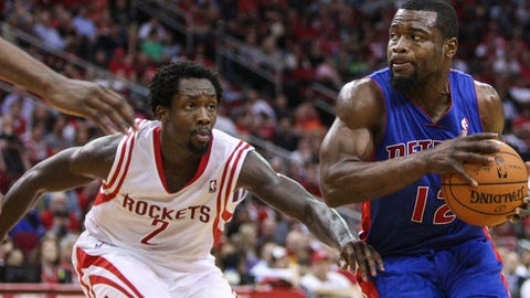 Mar 1, 2014; Houston, TX, USA; Detroit Pistons point guard Will Bynum (12) drives to the basket during the fourth quarter as Houston Rockets point guard Patrick Beverley (2) defends at Toyota Center. Mandatory Credit: Troy Taormina-USA TODAY Sports