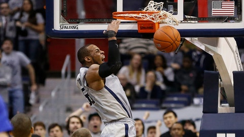 Mar 4, 2014; Washington, DC, USA; Georgetown Hoyas guard Jabril Trawick (55) dunks the ball against the Creighton Bluejays in the first half at Verizon Center. Mandatory Credit: Geoff Burke-USA TODAY Sports