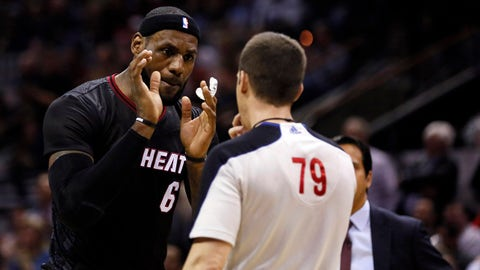 Mar 6, 2014; San Antonio, TX, USA; Miami Heat forward LeBron James (6) argues a call with referee Kevin Scott during the first half against the San Antonio Spurs at AT&T Center. Mandatory Credit: Soobum Im-USA TODAY Sports