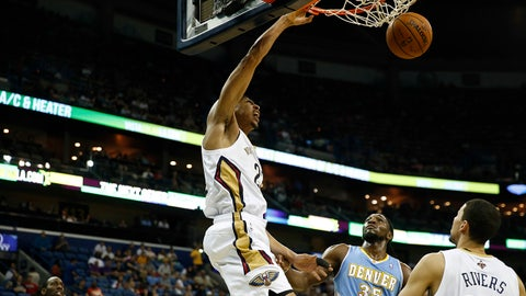 Mar 9, 2014; New Orleans, LA, USA; New Orleans Pelicans power forward Anthony Davis (23) dunks over Denver Nuggets power forward Kenneth Faried (35) during the first quarter of a game at the Smoothie King Center. Mandatory Credit: Derick E. Hingle-USA TODAY Sports