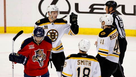 Mar 9, 2014; Sunrise, FL, USA; Boston Bruins center Carl Soderberg (34) celebrates his goal  with defenseman  Andrej Meszaros (41) and right wing Reilly Smith (18) as Florida Panthers center Vincent Trocheck (67) skates past in the second period at BB&T Center. Mandatory Credit: Robert Mayer-USA TODAY Sports