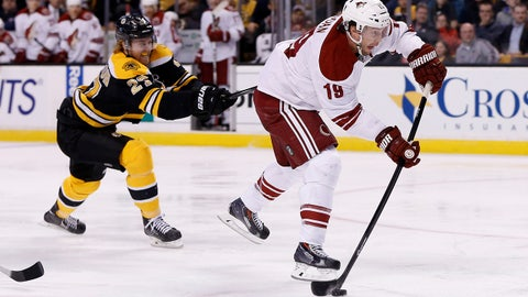 Mar 13, 2014; Boston, MA, USA; Phoenix Coyotes right wing Shane Doan (19) is pursued by Boston Bruins defenseman Dougie Hamilton (27) on a fast break during the second period at TD Banknorth Garden. Mandatory Credit: Greg M. Cooper-USA TODAY Sports