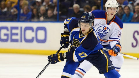 Mar 13, 2014; St. Louis, MO, USA; St. Louis Blues center Vladimir Sobotka (17) controls the puck against Edmonton Oilers center Ryan Nugent-Hopkins (93) during the second period at Scottrade Center. Mandatory Credit: Jasen Vinlove-USA TODAY Sports