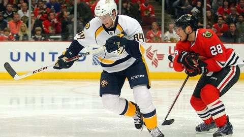 Mar 14, 2014; Chicago, IL, USA; Nashville Predators center Colton Sissons (84) being pursued by Chicago Blackhawks right wing Ben Smith (28) during the second period at the United Center. Mandatory Credit: Dennis Wierzbicki-USA TODAY Sports
