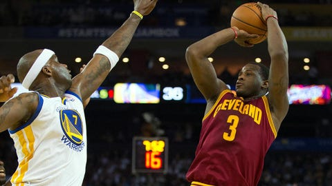 Mar 14, 2014; Oakland, CA, USA; Cleveland Cavaliers guard Dion Waiters (3) shoots the ball against Golden State Warriors center Jermaine O'Neal (7) during the second quarter at Oracle Arena. Mandatory Credit: Kelley L Cox-USA TODAY Sports
