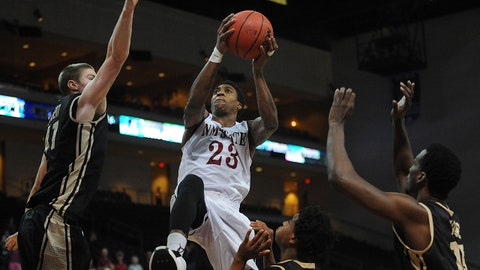 Mar 15, 2014; Las Vegas, NV, USA; New Mexico State Aggies player Daniel Mullings (23) shoots the ball between defending Idaho Vandals players Ty Egbert (41) and Mike Scott (12) in the championship game for the WAC Conference college basketball tournament at Orleans Arena. The Aggies won 77-55. Mandatory Credit: Stephen R. Sylvanie-USA TODAY Sports