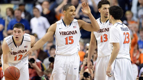 Mar 16, 2014; Greensboro, NC, USA;  Virginia Cavaliers guard Malcolm Brogdon (15) high fives teammates guard London Perrantes (23) forward Anthony Gill (13) and guard Joe Harris (12) in the final second against the Duke Blue Devils in the championship game of the ACC college basketball tournament at Greensboro Coliseum. Virginia defeated Duke 72-63. Mandatory Credit: John David Mercer-USA TODAY Sports