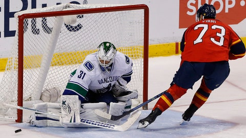 Mar 16, 2014; Sunrise, FL, USA; Vancouver Canucks goalie Eddie Lack (31) makes a save on a shot by Florida Panthers center Brandon Pirri (73) during the shootout at BB&T Center.  The Vancouver Canucks won 4-3. Mandatory Credit: Robert Mayer-USA TODAY Sports