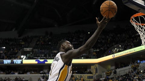 Mar 17, 2014; Indianapolis, IN, USA; Indiana Pacers guard Lance Stephenson (1) shoots over Philadelphia 76ers center Henry Sims (35) during the fourth quarter  at Bankers Life Fieldhouse. The Pacers won 99-90. Mandatory Credit: Pat Lovell-USA TODAY Sports