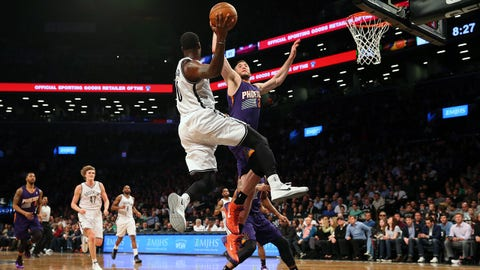 Mar 17, 2014; Brooklyn, NY, USA;  Brooklyn Nets center Andray Blatche (0) passes over Phoenix Suns center Miles Plumlee (22) during the fourth quarter at Barclays Center. Brooklyn Nets won 108-95.  Mandatory Credit: Anthony Gruppuso-USA TODAY Sports