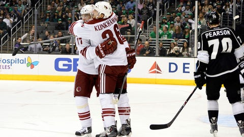 Mar 17, 2014; Los Angeles, CA, USA;  Phoenix Coyotes left wing Rob Klinkhammer (36) and right wing Radim Vrbata (17) celebrate a Coyotes first period goal against the Los Angeles Kings at Staples Center. Mandatory Credit: Robert Hanashiro-USA TODAY Sports