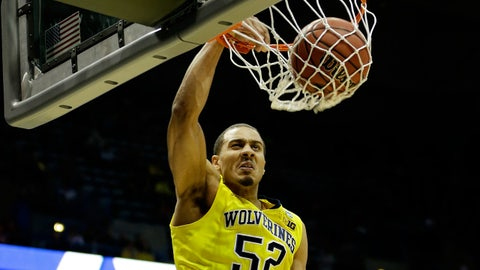 Mar 20, 2014; Milwaukee, WI, USA; Michigan Wolverines forward Jordan Morgan (52) dunks the ball during the second round of the 2014 NCAA Tournament against the Wofford Terriers at BMO Harris Bradley Center. Mandatory Credit: Jeff Hanisch-USA TODAY Sports