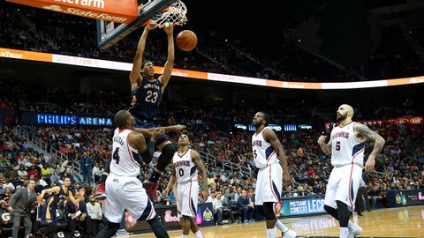 Mar 21, 2014; Atlanta, GA, USA; New Orleans Pelicans forward Anthony Davis (23) dunks against the New Orleans Pelicans during the fourth quarter at Philips Arena. The Pelicans won 111-105. Mandatory Credit: Kevin Liles-USA TODAY Sports