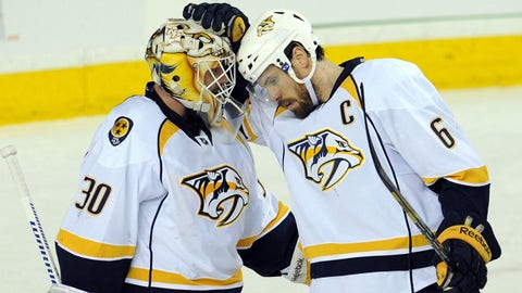 Mar 21, 2014; Calgary, Alberta, CAN; Nashville Predators goalie Carter Hutton (30) and defenseman Shea Weber (6) celebrate their win over the Calgary Flames at Scotiabank Saddledome. The Predators won 6-5. Mandatory Credit: Candice Ward-USA TODAY Sports