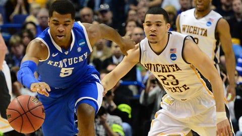 Mar 23, 2014; St. Louis, MO, USA; Kentucky Wildcats guard Andrew Harrison (5) chases a loose ball ahead of Wichita State Shockers guard Fred VanVleet (23) during the first half in the third round of the 2014 NCAA Men's Basketball Championship at Scottrade Center. Mandatory Credit: Jasen Vinlove-USA TODAY Sports