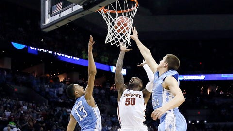 Mar 23, 2014; San Antonio, TX, USA; Iowa State Cyclones guard DeAndre Kane (50) shoots the game-winning shot against the North Carolina Tar Heels forward Jackson Simmons (21) and forward J.P. Tokoto (13) in the second half of a men's college basketball game during the third round of the 2014 NCAA Tournament at AT&T Center. Mandatory Credit: Soobum Im-USA TODAY Sports