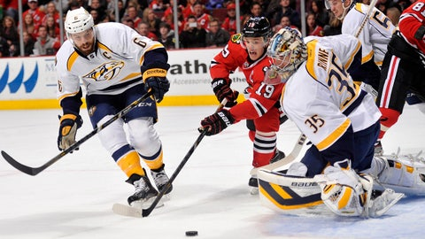 Mar 23, 2014; Chicago, IL, USA; Chicago Blackhawks center Jonathan Toews (19) shoots the puck against Nashville Predators goalie Pekka Rinne (35) during the first period at the United Center. Mandatory Credit: Rob Grabowski-USA TODAY Sports