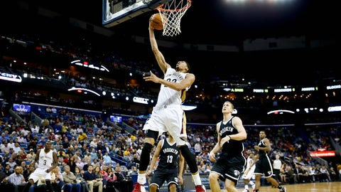 Mar 24, 2014; New Orleans, LA, USA; New Orleans Pelicans forward Anthony Davis (23) shoots over Brooklyn Nets forward Mason Plumlee (1) during the second quarter of a game at the Smoothie King Center. Mandatory Credit: Derick E. Hingle-USA TODAY Sports