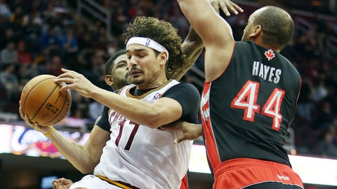 Mar 25, 2014; Cleveland, OH, USA; Cleveland Cavaliers center Anderson Varejao (17) looks to pass against Toronto Raptors forward Chuck Hayes (44) during the second quarter at Quicken Loans Arena. Mandatory Credit: Ron Schwane-USA TODAY Sports