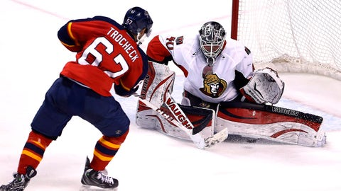 Mar 25, 2014; Sunrise, FL, USA; Florida Panthers center Vincent Trocheck (67) scores a goal under the pads of Ottawa Senators goalie Robin Lehner (40) in the second period at BB&T Center. Mandatory Credit: Robert Mayer-USA TODAY Sports