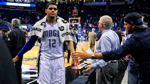 Mar 25, 2014; Orlando, FL, USA; Orlando Magic forward Tobias Harris (12) is congratulated by fans as he comes off the court as the Orlando Magic beat the Portland Trail Blazers 95-85 at Amway Center. Harris had a game-high 25 points. Mandatory Credit: David Manning-USA TODAY Sports