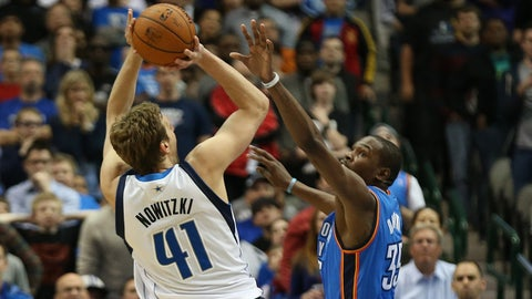Mar 25, 2014; Dallas, TX, USA; Dallas Mavericks forward Dirk Nowitzki (41) shoots against the Oklahoma City Thunder forward Kevin Durant (35) in overtime at American Airlines Center. The Mavs beat the Thunder 128-119 in overtime. Mandatory Credit: Matthew Emmons-USA TODAY Sports