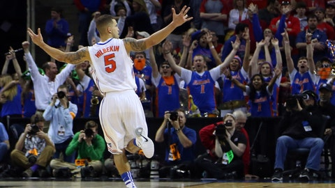 Mar 29, 2014; Memphis, TN, USA; Florida Gators guard Scottie Wilbekin (5) reacts at the end of the first half in the finals of the south regional of the 2014 NCAA Mens Basketball Championship tournament against the Dayton Flyers at FedEx Forum. Mandatory Credit: Spruce Derden-USA TODAY Sports