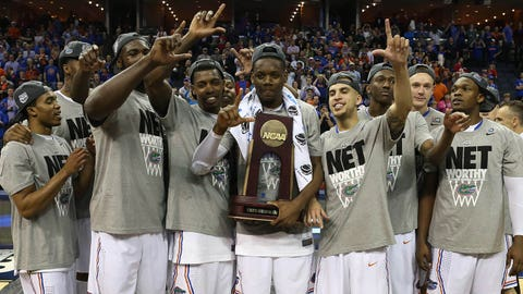 Mar 29, 2014; Memphis, TN, USA; Florida Gators celebrate defeating the Dayton Flyers 62-52 in the final in the south regional of the 2014 NCAA Mens Basketball Championship tournament at FedExForum. Mandatory Credit: Nelson Chenault-USA TODAY Sports