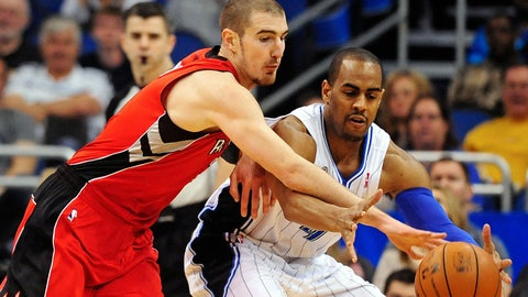 Mar 30, 2014; Orlando, FL, USA; Toronto Raptors guard Nando de Colo (3) battles for the ball with Orlando Magic guard Arron Afflalo (4) in the first half at Amway Center. Mandatory Credit: David Manning-USA TODAY Sports