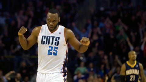 Mar 5, 2014; Charlotte, NC, USA; Charlotte Bobcats center Al Jefferson (25) reacts after the play during the second half against the Indiana Pacers at Time Warner Cable Arena. Bobcats won 109-87. Mandatory Credit: Joshua S. Kelly-USA TODAY Sports