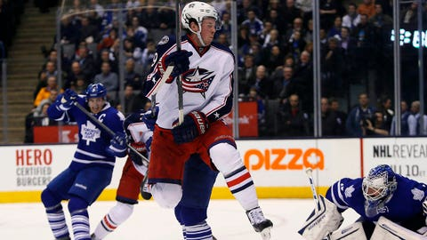 Mar 3, 2014; Toronto, Ontario, CAN; Columbus Blue Jackets forward Ryan Johansen (19) tries to get out of the way of shot on Toronto Maple Leafs goaltender James Reimer (34) during the second period at the Air Canada Centre. Mandatory Credit: John E. Sokolowski-USA TODAY Sports