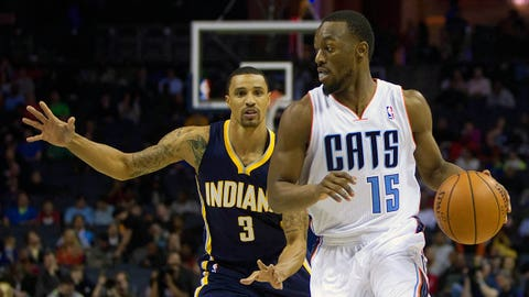 Mar 5, 2014; Charlotte, NC, USA; Charlotte Bobcats point guard Kemba Walker (15) drives to the basket while being defended by Indiana Pacers point guard George Hill (3) during the first quarter at Time Warner Cable Arena. Mandatory Credit: Joshua S. Kelly-USA TODAY Sports