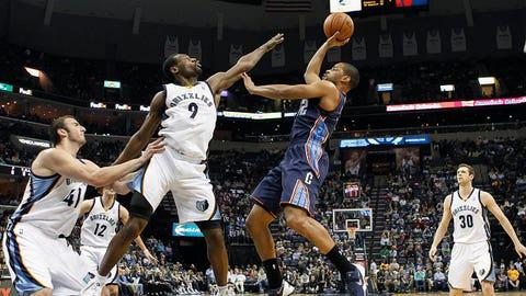 Charlotte Bobcats guard Gary Neal (12) shoots against Memphis defenders Kosta Koufos (41), Tony Allen (9) and Jon Leuer (30) in the first half of an NBA basketball game Saturday, March 8, 2014, in Memphis, Tenn. (AP Photo/Lance Murphey)