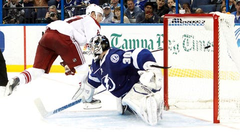 Mar 10, 2014; Tampa, FL, USA; Phoenix Coyotes right wing Radim Vrbata (17) shoots the game winning shoot out goal on Tampa Bay Lightning goalie Ben Bishop (30) at Tampa Bay Times Forum. Phoenix Coyotes defeated the Tampa Bay Lightning 4-3 in a shoot out. Mandatory Credit: Kim Klement-USA TODAY Sports