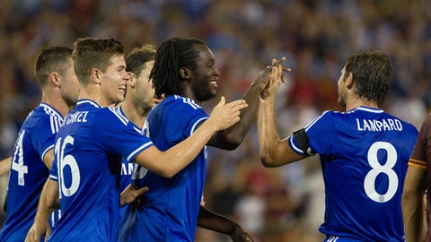 Aug 10, 2013; Washington, DC, USA; Chelsea forward Romelu Lukaku (center) celebrates with Chelsea midfielder Marco Van Ginkle (16) and midfielder Frank Lampard (8) after scoring a goal against AS Roma during the second half at RFK Stadium. Mandatory Credit: Paul Frederiksen-USA TODAY Sports