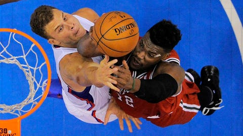 Milwaukee Bucks forward Jeff Adrien, right, goes up for a shot as Los Angeles Clippers forward Blake Griffin defends during the second half of an NBA basketball game, Monday, March 24, 2014, in Los Angeles. The Clippers won 106-98. (AP Photo/Mark J. Terrill)