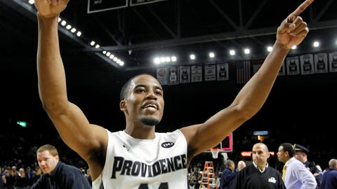 Mar 4, 2014; Providence, RI, USA; Providence Friars guard Bryce Cotton (11) celebrates after making two free throws in the final second to defeat the Marquette Golden Eagles 81-80 in double overtime at the Dunkin' Donuts Center. Mandatory Credit: Stew Milne-USA TODAY Sports