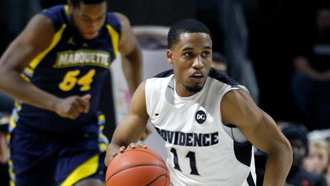 Mar 4, 2014; Providence, RI, USA; Providence Friars guard Bryce Cotton (11) dribbles up court during the second half against the Marquette Golden Eagles at the Dunkin' Donuts Center. Mandatory Credit: Stew Milne-USA TODAY Sports