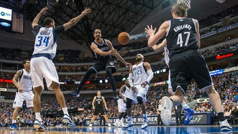 Mar 23, 2014; Dallas, TX, USA; Brooklyn Nets guard Shaun Livingston (14) passes to forward Andrei Kirilenko (47) during the first half against the Dallas Mavericks at the American Airlines Center. Mandatory Credit: Jerome Miron-USA TODAY Sports