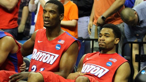 Mar 29, 2014; Memphis, TN, USA; Dayton Flyers forward Dyshawn Pierre (left) and Dayton Flyers guard Vee Sanford (right) reacts during the second half in the finals of the south regional of the 2014 NCAA Mens Basketball Championship tournament against the Florida Gators at FedEx Forum. Florida won 62-52. Mandatory Credit: Spruce Derden-USA TODAY Sports