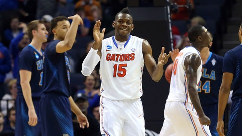 Mar 27, 2014; Memphis, TN, USA; Florida Gators forward Will Yeguete (15) reacts during the second half in the semifinals against the UCLA Bruins in the south regional of the 2014 NCAA Mens Basketball Championship tournament at FedExForum. Mandatory Credit: Spruce Derden-USA TODAY Sports