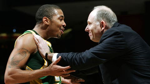 DAYTON, OH - MARCH 19:  Lamar Butler #22 of the George Mason Patriots celebrates with Coach Jim Larranaga during the game against the North Carolina Tar Heels in the Second Round of the 2006 NCAA Men's Basketball Tournament at the University of Dayton Arena March 19, 2006 in Dayton, Ohio. George Mason won 65-60.  (Photo by Andy Lyons/Getty Images)