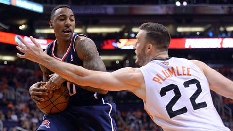 Mar 2, 2014; Phoenix, AZ, USA; Atlanta Hawks point guard Jeff Teague (0) protects a rebound from Phoenix Suns center Miles Plumlee (22) in the first half at US Airways Center. Mandatory Credit: Joe Camporeale-USA TODAY Sports