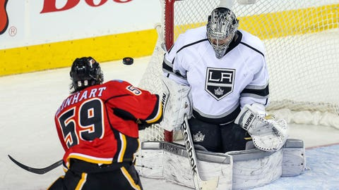 Mar 10, 2014; Calgary, Alberta, CAN; Los Angeles Kings goalie Martin Jones (31) makes a save as Calgary Flames center Max Reinhart (59) tries to score during the third period at Scotiabank Saddledome. Los Angeles Kings won 3-2. Mandatory Credit: Sergei Belski-USA TODAY Sports