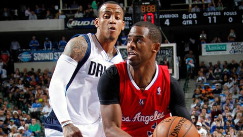 DALLAS, TX - MARCH 27: Chris Paul #3 of the Los Angeles Clippers drives against Monta Ellis #11 of the Dallas Mavericks on March 27, 2014 at the American Airlines Center in Dallas, Texas. NOTE TO USER: User expressly acknowledges and agrees that, by downloading and or using this photograph, User is consenting to the terms and conditions of the Getty Images License Agreement. Mandatory Copyright Notice: Copyright 2014 NBAE (Photo by Glenn James/NBAE via Getty Images)