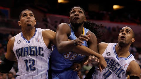 Mar 12, 2014; Orlando, FL, USA; Orlando Magic forward Tobias Harris (12), Denver Nuggets forward Kenneth Faried (35) and Magic guard Arron Afflalo (4) fight for position during the second quarter at Amway Center. Mandatory Credit: Kim Klement-USA TODAY Sports