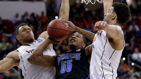 Memphis guard Geron Johnson (55) shoots against Virginia's Justin Anderson, left, and Anthony Gill (13) during the first half of an NCAA college basketball third-round tournament game, Sunday, March 23, 2014, in Raleigh. (AP Photo/Chuck Burton)