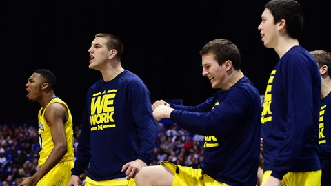 Mar 28, 2014; Indianapolis, IN, USA; Michigan Wolverines players celebrate after a basket against the Tennessee Volunteers in the second half in the semifinals of the midwest regional of the 2014 NCAA Mens Basketball Championship tournament at Lucas Oil Stadium. Mandatory Credit: Bob Donnan-USA TODAY Sports