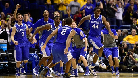 Mar 23, 2014; St. Louis, MO, USA; Kentucky Wildcats celebrate as the defeat the Wichita State Shockers 78-76  in the third round of the 2014 NCAA Men's Basketball Championship at Scottrade Center. Mandatory Credit: Scott Rovak-USA TODAY Sports